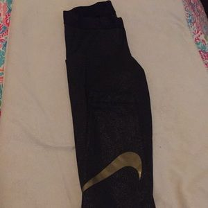 Black/gold Nike glitter tights with gold swoosh, M